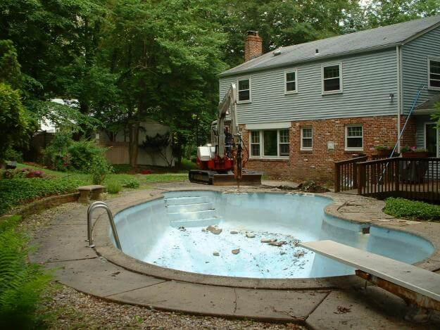 Cost of Removing a Swimming Pool | SANI-TRED Blog